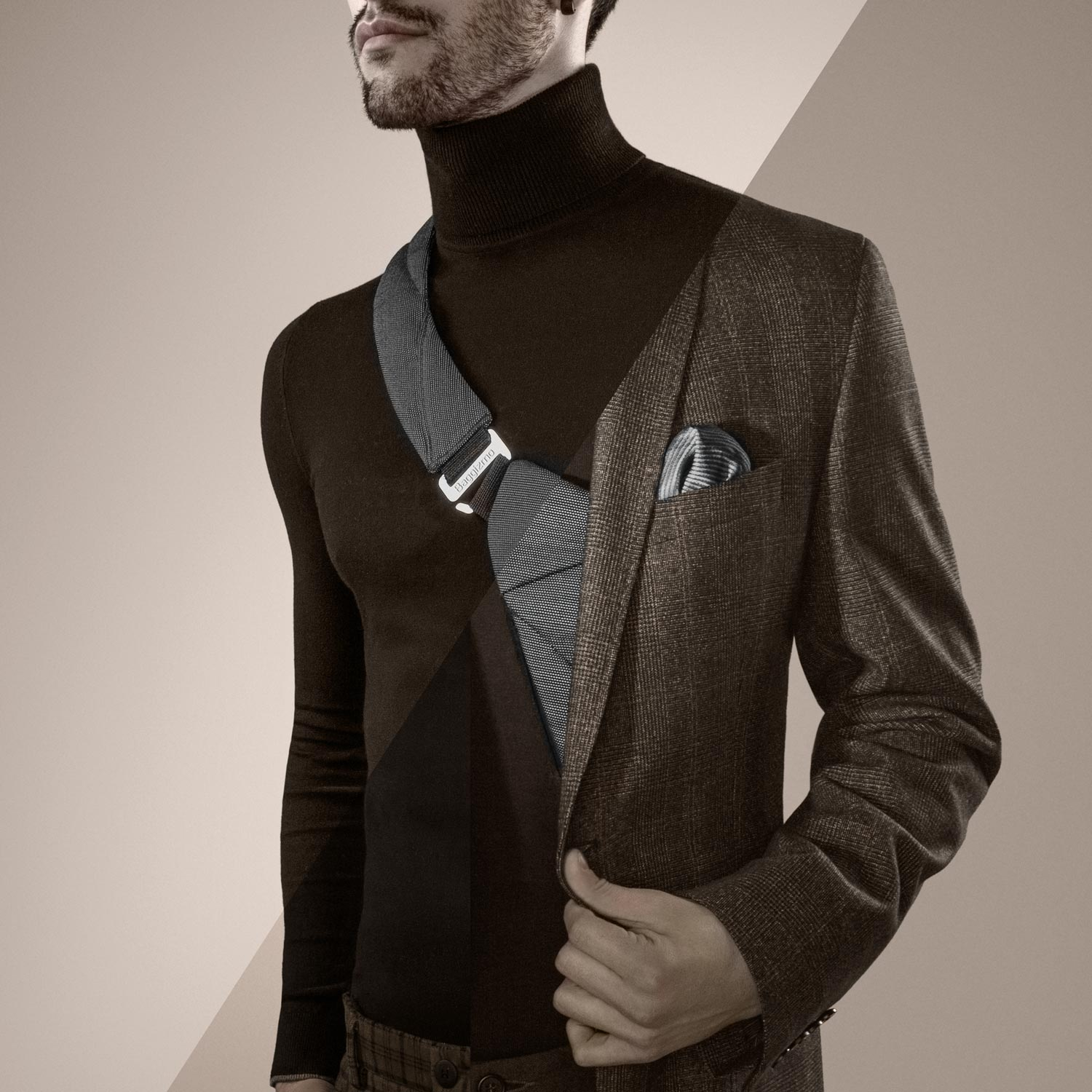 Man wearing a blazer, a turtleneck and slim crossbody bag