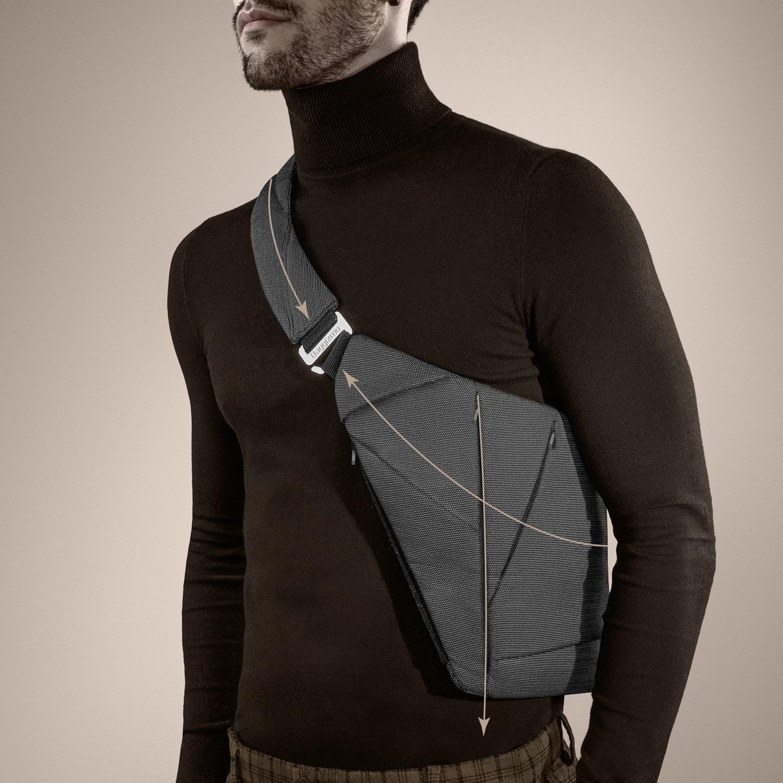 Man in a turtleneck wearing slim textile crossbody bag