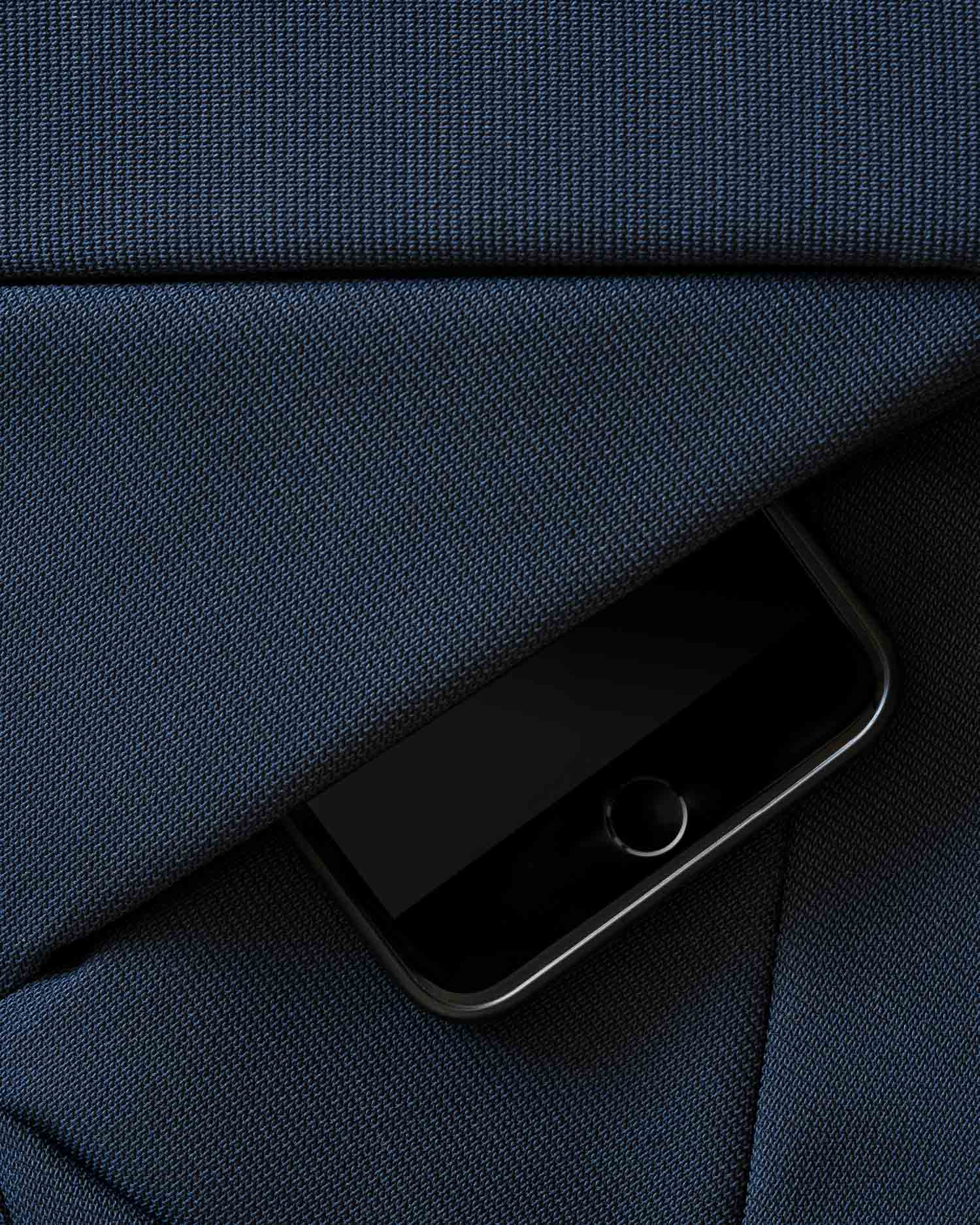 Scholler innovative textile for Baggizmo bag with iPhone sticking out of the pocket