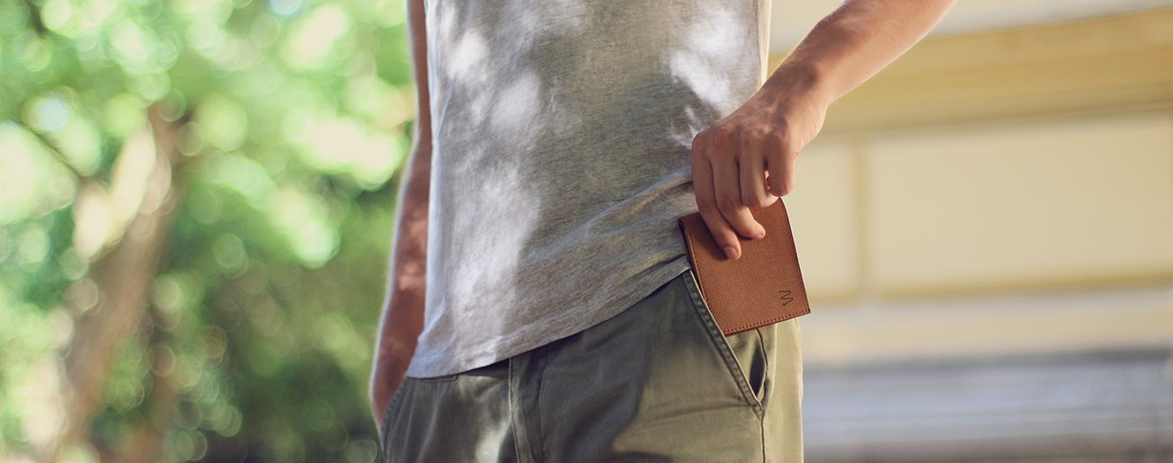 Man putting a smart wallet into his pocket