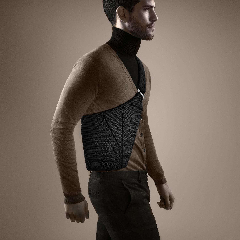 Man in brown cardigan wearing Baggizmo textile crossbody bag