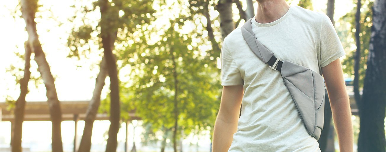Why Men's Chest Bag Is a Must - Man wearing a chest bag