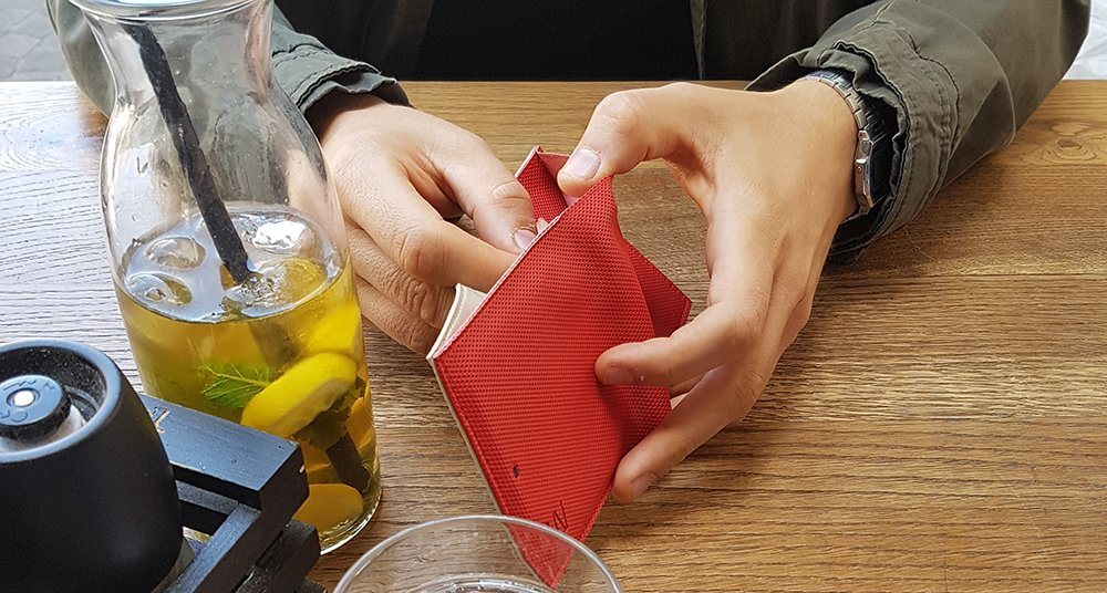 Man holding a red card wallet