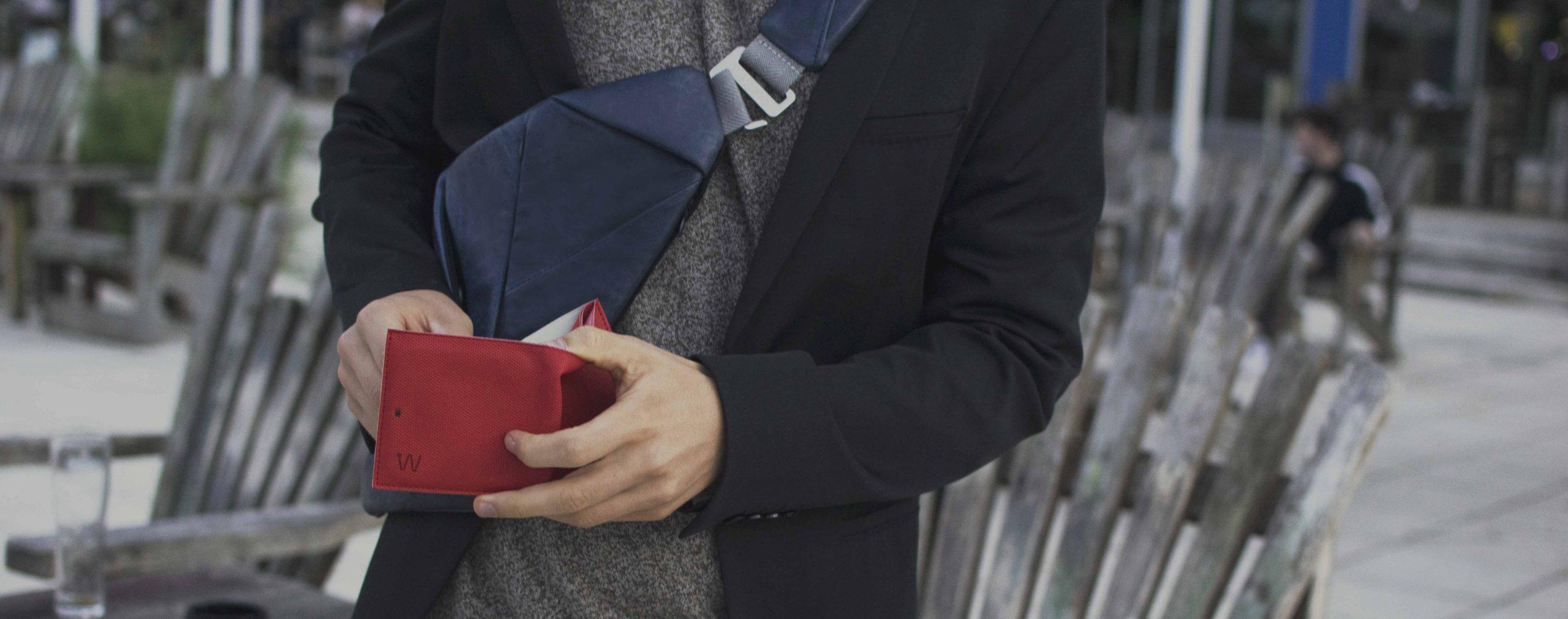Man holding a smart wallet