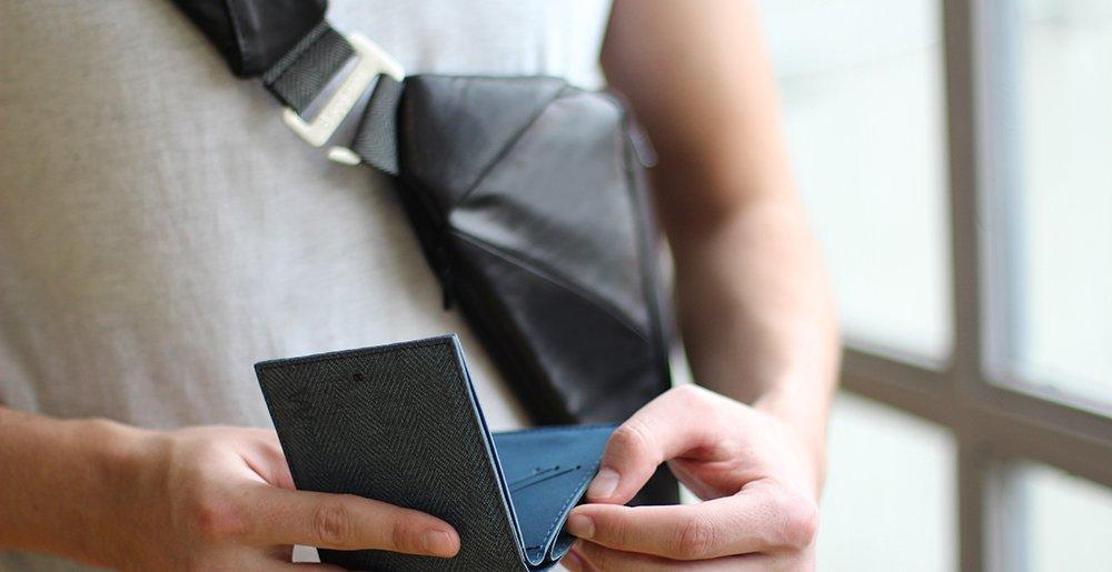 man wearing leather crossbody bag