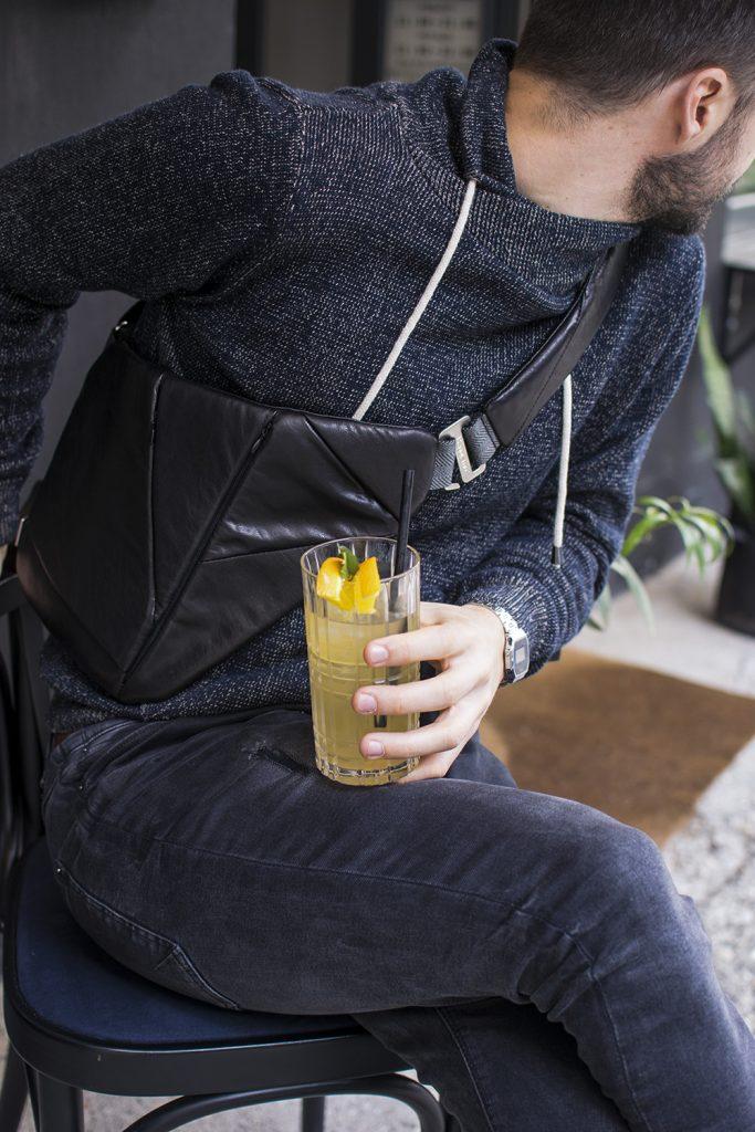 man wearing black leather corssbody bag