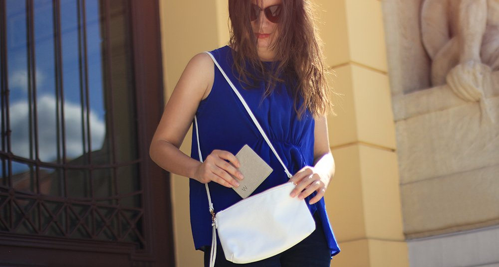 woman holding a slim wallet
