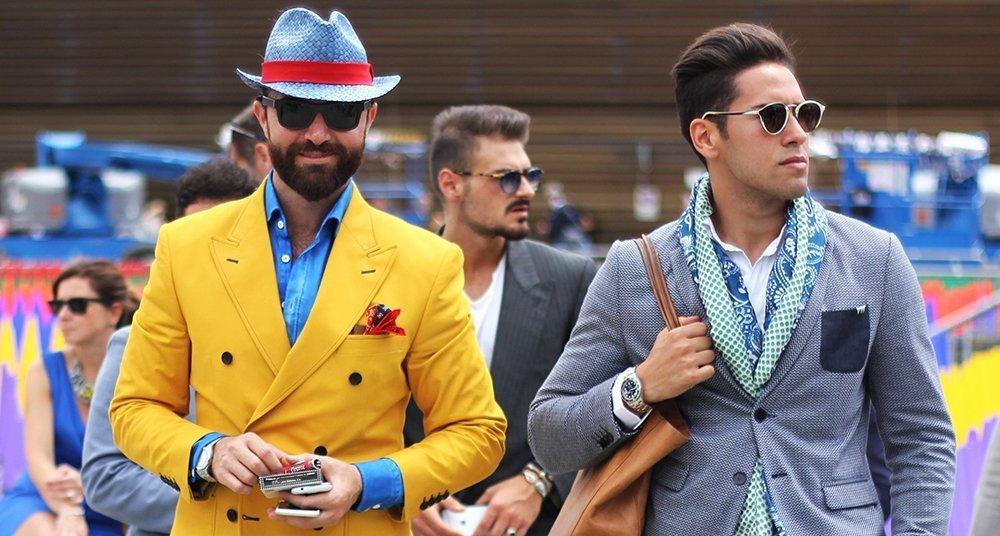 Men at fashion week with manbags