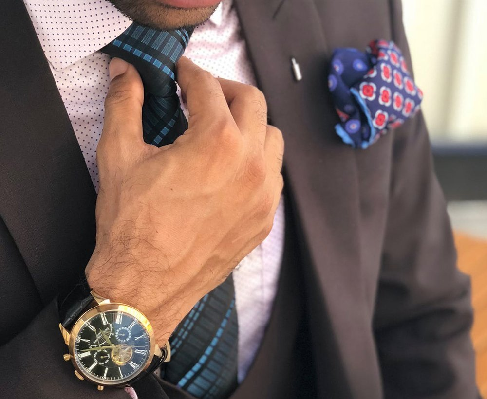 A man in suit and tie with a nice watch